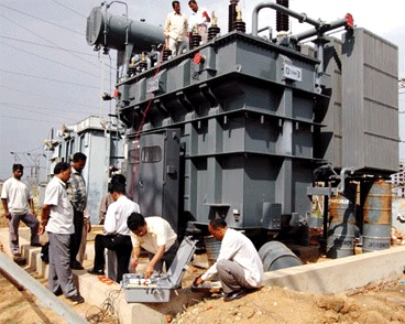 Men doing routine testing on a transformer